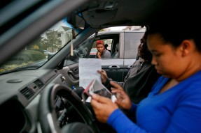Diamond Gilmore, Julissa Sosa and her fiancŽ, Phillip Barada, check a list of possible housing options during a day of apartment hunting on Tuesday, November 1, 2016. Originally, Sosa and Barada were trying to keep their two sons in the same schools, but they soon realized that with limited options, that wasn't going to be possible. Gilmore, Sosa and Barada didn't know each other prior to being displaced but have grown to become close friends.