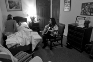 "Shelly Simonds plays guitar for Jim as he lies in bed at Commonwealth Assisted Living in Hampton Monday afternoon March 28, 2016. Jim died from Alzheimer's April 2, 2016. Jim was diagnosed by the National Institute of Health in 2011 with ""mild cognitive impairment,"" the precursor to early-onset Alzheimer's disease. The genetically pre-determined disease has devastated his family--his mother died of the disease at age 61, his older brother at 52."
