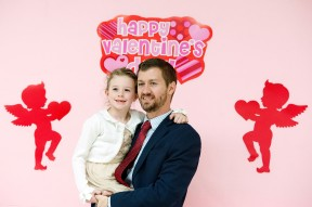 Andrew Witmer, of Harrisonburg, holds his daughter, Katherine, 6, as they get a photo taken at the third annual Daddy Daughter Sweetheart Dance.