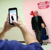 Mike Love, of Harrisonburg, stands with his daughter, Aubrey, 4, as they get their photo taken by Danny McDonald, a 20-year-old Harrisonburg Parks and Recreation worker.