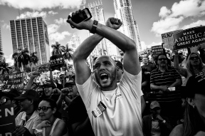 "HM: Election: M. Scott Mahaskey, Politico--A campaign volunteer yells ""lock her up"" as Donald J. Trump holds a campaign rally Nov. 2, 2016 at the Bayfront Park Amphitheater in Miami, Florida. The phrase became a rally cry across the United States as Trump supporters believed former Sec. of State Hillary Clinton should be charged over various actions during her time as secretary."