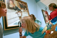 HM Feature: Heather Rousseau, Roanoke Times--Maverick Johnston (from left), 7, Naomi Lankford, 6, and Lydia Lankford, 10, re-enact Norman RockwellÕs painting titled ÒArt Critic,Ó at the Taubman Museum of Art on Wednesday. ÒAmerican Chronicles: The Art of Norman RockwellÓ is on exhibit at the museum until June 12. The home-schoolers from Botetourt County attended the TaubmanÕs childrenÕs program and recreated scenes from the exhibit, using props provided by the museum.