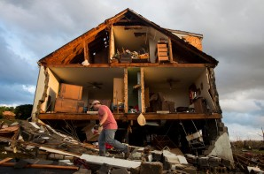 HM Spot News: Jill Nance Waugh, News & Advance-- Nick Mobley helps finds possessions for the house owned by Jack Baker at 13720 Richmond Highway on February 24, 2016, a hour after an EF3 categroy tornado tore miles-long swatch of damage through in Appomattox County, Va.