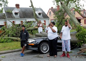 HM Spot News: P. Kevin Morley, Richmond Times-Dispatch--Ameyah Graves (far left) couldn't believe that her mother's car was totaled by a fallen tree during Thursday night's storm. She and neighbors along Patrick Avenue lost their power. From left: Ameyah Graves, Jamya Mobley (11), Aquan Mobley (7), their mother Audreyel Mobley and Audreyel's husband, Jonas Baptist.