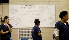 (From left) Amanda Lewis, Dalila Rodriguez and Madlyn Ward walk around the common area of their pod at the Chesterfield County Jail on Oct. 19, 2016. The board in the common area includes recovery quotes and their motto.