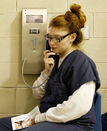 Holly Johnson makes a phone call in the common area of the pod at the Chesterfield County Jail on Oct. 19, 2016. Johnson is part of an opioid program in the jail.