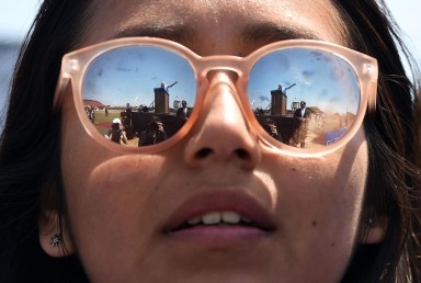 3rd Place News Picture Story: Matt McClain, Washington Post-- Presidential candidate, Bernie Sanders attracted a large number of young voters and a large voter base as he campaigned for president. Surprising many, Sanders came close to capturing the Democratic nomination. He ultimately lost to Hillary Clinton. Presidential candidate, Bernie Sanders reflected in the sunglasses of Daisi Hernandez, 18, as he speaks at a rally at Santa Maria High School on Saturday May 28, 2016 in Santa Maria, CA.