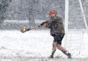 "HM Sports Picture Story: Alexa Welch Edlund, Richmond Times-Dispatch-- Duffy, head coach of Richmond's hurling team, the Richmond Battery GAA, jokingly describes the game as ""a cross between the skills of lacrosse, baseball, rugby and ... second-degree murder."" The team didn't let the snow deter their practice."