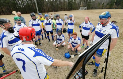 Richmond Battery GAA Coach Niall Duffy talks to his team before playing the Hampton Roads Hurling Club at the James City County Recreation Center field Saturday, February 20, 2016.