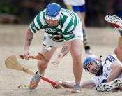 Richmond Battery GAA's Will O'Brien watches as Hampton Roads Hurling Club's Jeremy Hancock tosses the sliotar on his hurley during a match at the James City County Recreation Center field Saturday, February 20, 2016.