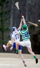 (L-R) Richmond Battery GAA's Will O'Brien and Hampton Roads Hurling Club's Paul Cannon compete for the sliotar during a match at the James City County Recreation Center field Saturday, February 20, 2016. ,