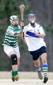 (L-R) Hampton Roads Hurling Club's Zach Otto and Richmond Battery GAA's Peter Hoskins compete for the sliotar during a match at the James City County Recreation Center field Saturday, February 20, 2016.