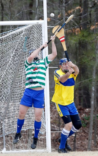 Richmond Battery GAA goalkeeper Stephen Foster, right, tries to prevent a score by Hampton Roads Hurling Club's Donovan Hall at the James City County Recreation Center field Saturday, February 20, 2016.