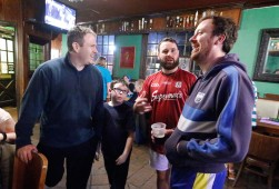 (L-R) Niall Duffy, his nine-year-old son Noah Duffy, Joshua Parker and Alan Delahunty gathered at Green Leaf Cafe in Williamsburg after their team, Richmond Battery GAA, played the Hampton Roads Hurling Club at the James City County Recreation Center field Saturday, February 20, 2016.