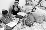 Tia Watkins reads with her daughter, Jori Watkins and son, Shawn Watkins Jr. at the home where they live on Tuesday July 26, 2016 in Severn, MD. Tia plays full-contact football for the D.C. Divas.