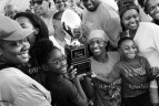 Tia Watkins, right, poses for a photograph with family and friends following the Women's Football Alliance championship game or W Bowl against the Dallas Elite at West Allegheny High School on Saturday July 23, 2016 in Imperial, PA. Tia plays for the D.C. Divas, a full-contact female football team. The Divas won the game.