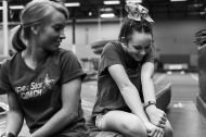 Dynamic Cheer Super Stars coach Liz Matts talks with Haley Coleman, 15, during a team practice on Saturday March 26, 2016 in Lynchburg, VA.