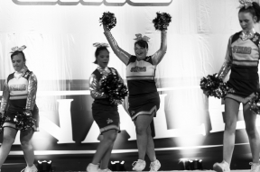 "Kelsey Minnick, 19, takes the stage with the rest of the Dynamic Cheer Super Stars as they prepare to perform during the Cheer and Dance Extreme Finale on Saturday April 9, 2016 in Virginia Beach, VA. ""The girls are enjoying it. … When that spotlight hits them onstage, they're in a world of their own. They want to show off,"" said Tony Torrence, Minnick's grandfather."