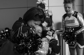 Dynamic Cheer Super Stars coach Kristen Rondeau hugs Emily Barker, 16, before the team performs at the Cheer and Dance Extreme Finale on Saturday April 9, 2016 in Virginia Beach, VA.