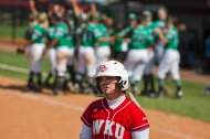 Pitcher Hannah Parker walks off the field after being put out in the last inning of the Lady Toppers 9-6 loss against University of North Texas on Saturday March 26, 2016 at WKU Softball Complex in Bowling Green, Ky. Parker was at bat 4 times with one hit, one home run.