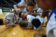 William Fleming's guard Vonkuren Saunders (center) is pinched on the nose as the team celebrates after defeating Cave Spring in overtime of championship round of the K-Guard Holliday classic basketball tournament on Friday December 30, 2016 at Salem Civic Center in Salem, VA.