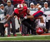 WKU's wide receiver Taywan Taylor (2) dives into the end zone to score a touchdown as Florida Atlantic defensive back Cre'von LeBlanc (7) holds his arm during the first half of the WKU-Florida Atlantic football game on Saturday Nov. 7 at L. T. Smith Stadium in Bowling Green, Ky.