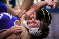 David Giantonio junior at Christiansburg high school wraps his arm around Bake Hohman, junior at New kent High school, neck during a VHSL finals on Saturday February 22, 2014. David won states in his weight class of 145pounds.