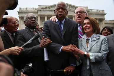 Following the unforeseen shooting in Orlando, Democrats demand for reform on gun control laws. After an over 24-hour sit-in on the House floor, Minority Leader Nancy Pelosi (D-Calif.) clutches onto Rep. John Lewis (D-Ga.) as he addresses reporters and protestors, promoting their aggressive campaign towards strict gun laws on June 23, 2016.