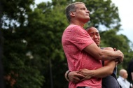 Hundreds come together in Dupont Circle in Washington, D.C. on June 13, 2016 for a candlelight vigil honoring the victims of the deadly attack in Orlando, Fla. A couple shares the comfort of a warm embrace as the names of the victims are read aloud.