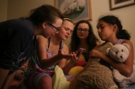 Lola and her friends play with Siri on her phone on November 4, 2016. Lola attempts to maintain normalcy by hosting a slumber party.
