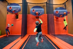 "Lucas Wooldridge (left), Ladon Wooldridge and Lucas Solorzano shoot baskets while at Jump Trampoline Park on Monday. The park usually opens at 3:00 but opened in the morning for kids to enjoy while off of school because of the snow. ""Obviously parents want to get their kids out and get all that energy out,"" said owner Brent Fortenberg. ""We wanted to give them that option."" The park opened in November on Candlers Mountain Road, making it the third location for Jump Trampoline Parks with other locations in Charlottesville and Virginia Beach. Fortenberg plans on opening the park whenever there is a snow day. ""As long as it's doable we want to be able to reach the community any way we can."""