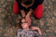 Megan Harris stretches the neck of her daughter Emmeline Harris, 8, at the family's home on Thursday Feb. 2, 2017 in Sweet Briar, Va. Emmeline was born with a rare condition knows as CHARGE Syndrome that affects one in every 8,000-10,000 births according to the CHARGE Syndrome Foundation. CHARGE Syndrome can have a wide variety of symptoms that include vision impairment, hearing loss, heart defects and developmental delays.