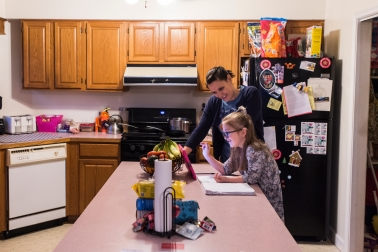 Emmeline Harris, 8, does her homework with the help of her mother Megan Harris on Thursday Feb. 2, 2017 in Sweet Briar, Va. Emmeline has a sever articulation disorder which can make it difficult for others to understand her when she talks.