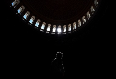 WASHINGTON, DC - May 03: A visitor is illuminated while passing through the rotunda at the United States Capitol on Wednesday May 03, 2017 in Washington, DC.