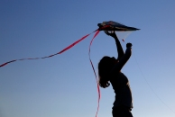 Aliza Matos, 11, attempts to fly her kite into the air at Riverview Farm Park Wednesday evening May 3, 2017.