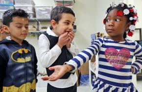 From left: Yancarlo Villanueva, Laith Almahdi, 5, and Dasiyah Newby, 5, share a moment while waiting in line to leave art class at Carver Elementary School on Thursday, March 30, 2017.