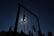 ANNAPOLIS, MD - May 16: Naval Academy plebes climb ropes that were part of an obstacle course during the annual Sea Trials at the United States Naval Academy on Tuesday May 16, 2017 in Annapolis, MD.
