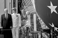 From left, Vice President Mike Pence, Commander Jesse J. Zimbauer, and Matt Mulherin, president of Newport News Shipbuilding, watch as ship sponsor Diane Donald smashes a bottle of sparkling wine across the hull of the Virginia-class submarine Indiana during the christening ceremony at Newport News Shipbuilding Saturday morning April 29, 2017.