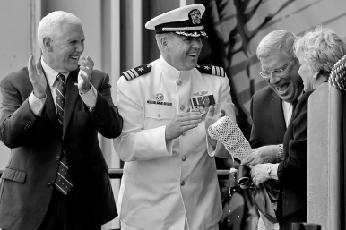 From left, Vice President Mike Pence, Commander Jesse J. Zimbauer, and Matt Mulherin, president of Newport News Shipbuilding, celebrate after ship sponsor Diane Donald smashed a bottle of sparkling wine across the hull of the Virginia-class submarine Indiana during the christening ceremony at Newport News Shipbuilding Saturday morning April 29, 2017.