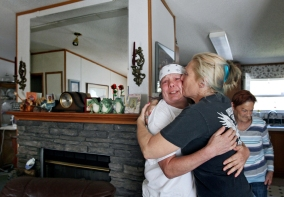 Arriving from Smithfield, Va., family friend and long-time supporter Lisa Fry, left, shares a hug with Pamela Scott, right, at Scott's mother's home in the Outer Banks of North Carolina. In early 1987 at the age of 23, addicted and selling cocaine, Scott was convicted of first degree murder and robbery in Hampton, Va. While incarcerated she received her GED, became licensed for cosmetology and is now living as a hair dresser in North Carolina. Scott falls under Virginia's old parole laws, in which a five-member state board determines whether to release inmates. Tuesday, March 21, 2017