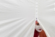 A mime with Virginia Beach-based Magical Solutions prepares to exit a tent and perform at Hampton Roads PrideFest on June 17, 2017 in Town Point Park.