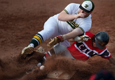 Northside High School third baseman Sam McLaughlin (23) loses the ball as Cave Spring's Logan Altizer (7) slides into third safely during the first inning of the Region 3A West quarter final at Northside High School Tuesday evening, May 30, 2017. Cave Spring won 4-3.