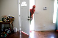 Donald Traynham, of Williamsburg, Va., dressed as Spiderman, peers through the front door at the home of Zack Cissell, on Friday, September 22, 2017 before they left for a charity event they were performing at that evening. The duo, along with Chloe Bethune, are all members of the The Hampton Roads Superhero Squad.