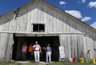 Rick Huffman, center, covers his heart during the playing of the national anthem as he gathers with others before the start of harness racing at the Clark County Fair on Sunday July 30, 2017 in Kahoka, MO. The fair, which began in 1881 featured a demolition derby, tractor pull, and livestock competitions among other attractions. There used to be several days of harness racing at the fair in the past, this year it was on one day. Huffman was competing in the racing.
