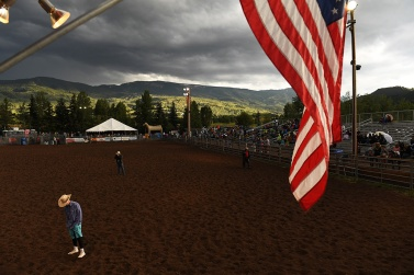 """The weeks following July 4th out west is known as """"Cowboy Christmas"""" for the number of rodeos that are held and available to participate in. Rodeos have their root in working ranches that held competitions where workers could test their skills. People gather under a threatening sky that produced showers during the Snowmass Rodeo on Wednesday July 19, 2017 in Snowmass Village, CO. This is the 44th year for the weekly rodeo that runs from mid-June through August."""