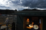 Katie Ford, center, is seen in a shed used for participants to sign up to compete and other rodeo business at the Snowmass Rodeo on Wednesday July 19, 2017 in Snowmass Village, CO. This is the 44th year for the weekly rodeo that runs from mid-June through August.