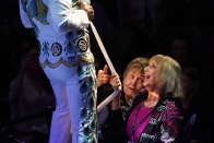 "Linda Erwin, right, of Spartanburg, SC tries to secure a scarf from Elvis Tribute Artist, Diogo ""Di"" Light during the Images of the King World Championship at the New Daisy Theatre on Monday August 14, 2017 in Memphis, TN. August 11-19 is Elvis Week. This year marks the 40th year since Elvis Presley's death."