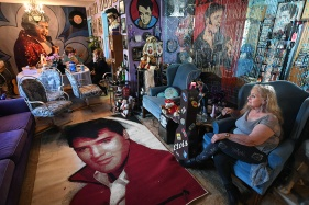 Mary Stonebraker sits in the living room of her home that is directly behind Elvis Presley's Graceland on Friday August 11, 2017 in Memphis, TN. She and her husband, Bud Stonebraker have lived in the home for 22 years. Bud refers to he and his wife as more Elvis fanatics than just fans. Their house is decked out with Elvis memorabilia. They hosted free concerts in their backyard during Elvis Week.