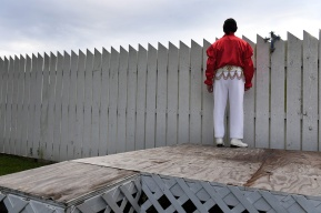 Elvis Tribute Artist, Jimmy Smith of Aiken, SC looks over a fence at Graceland from the backyard of Bud and Mary Stonebraker on Monday August 14, 2017 in Memphis, TN. The couple have lived directly behind Elvis Presley's Graceland for 22 years. Bud refers to he and his wife as more Elvis fanatics than just fans. Their house is decked out with Elvis memorabilia. They hosted free concerts in their backyard during Elvis Week.