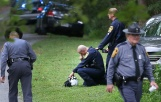 Authorities near the scene of the helicopter crash near Charlottesville on Saturday Aug. 12, 2017. Virginia State Police confirmed two deaths in the crash.